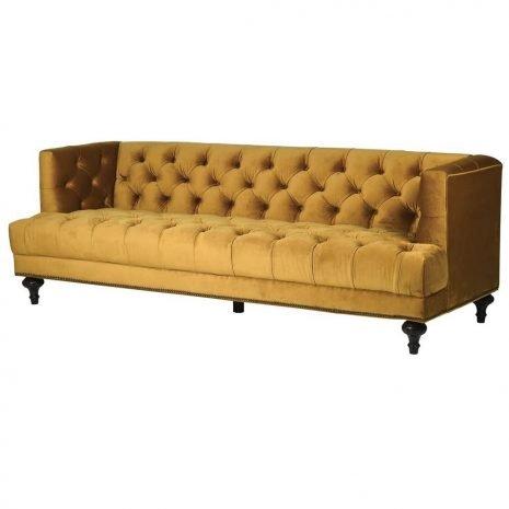 mustard button back sofa